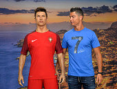 Portugese forward Cristiano Ronaldo poses next to a wax statue representing himself during a visit to the new location of the CR7 museum dedicated...