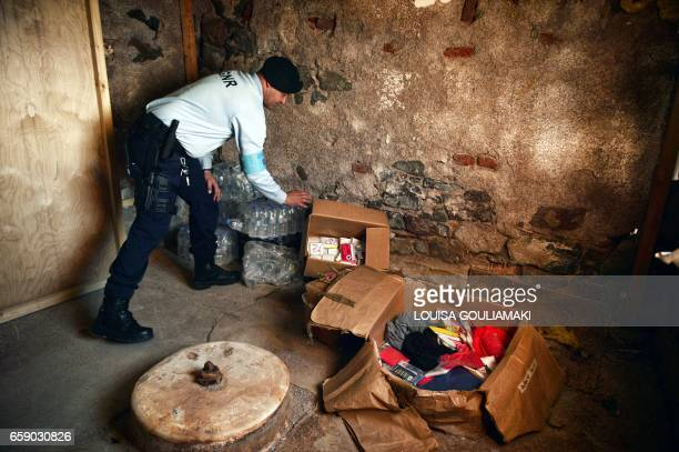 A Portugese officer serving for the European Border and Coast Guard Agency check boxes during a patrol in Skala Sykamias at the north part of the...