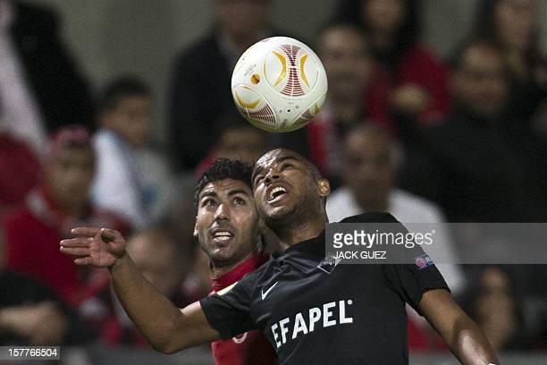 Portuguese Academica de Coimbra's defender Nivaldo challenges Hapoel Tel Aviv's defender Iyad Khutaba during their UEFA Europa League Group B...