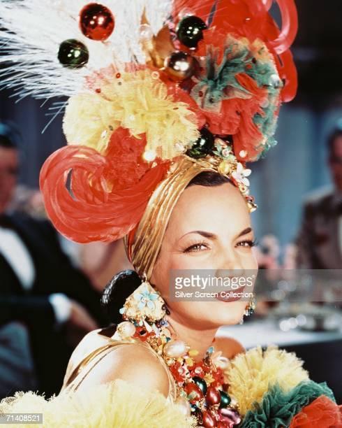 Portuguese actress and singer Carmen Miranda in one of her trademark extravagant headdresses circa 1950