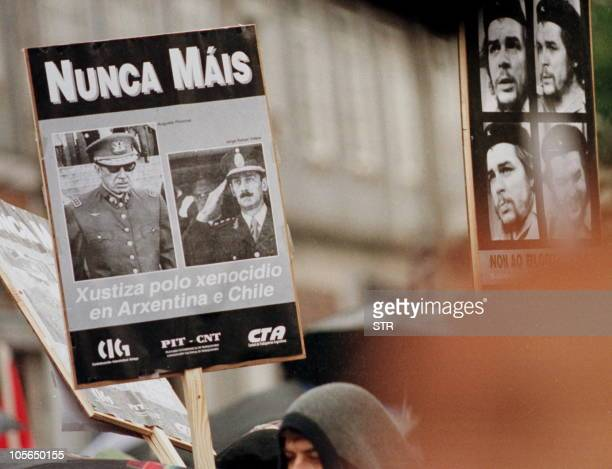 Portuguese and Spanish supporters of Cuban president Fidel Castro carry posters denouncing former dictators Gen Augusto Pinochet of Chile and...