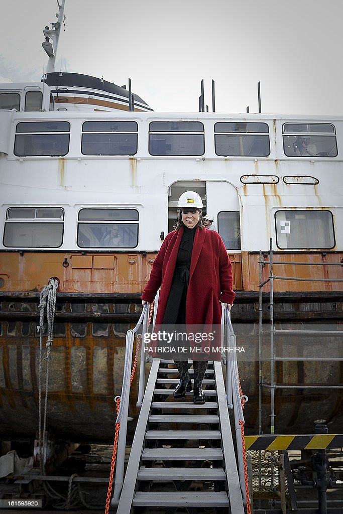 Portuguese artist Joana Vasconcelos gets off an old boat from Lisbon, named 'Cacelheiro', that will be the platform to the future Portugal pavilion that will represent the country at the next Venice Biennale, during the official presentation of the project in Seixal, near Lisbon, on February 12, 2013.