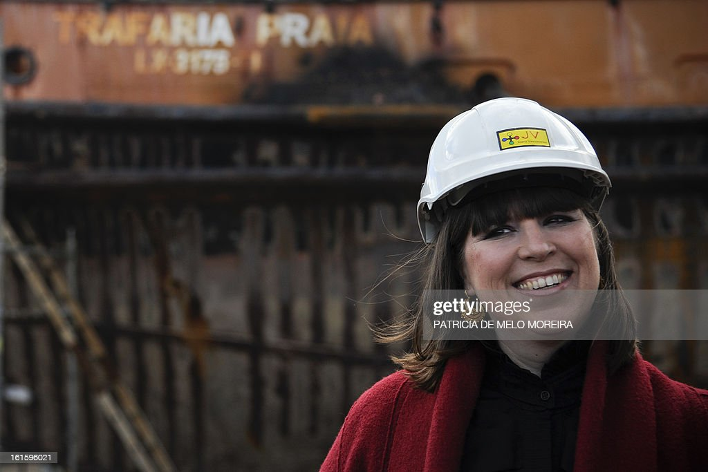 Portuguese artist Joana Vasconcelos smiles during the official presentation of an old boat from Lisbon, named 'Cacelheiro', that will be the platform to the future Portugal pavilion that will represent the country at the next Venice Biennale, in Seixal, near Lisbon, on February 12, 2013. AFP PHOTO / PATRICIA DE MELO MOREIRA