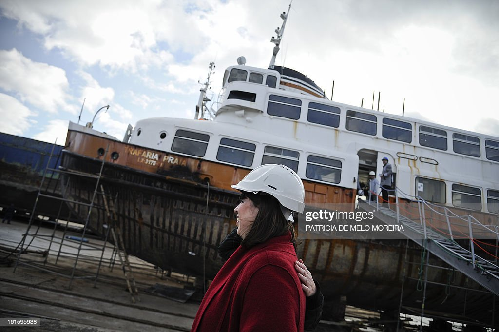 Portuguese artist Joana Vasconcelos stands next to an old boat from Lisbon, named 'Cacelheiro', that will be the platform to the future Portugal pavilion that will represent the country at the next Venice Biennale, during the official presentation of the project in Seixal, near Lisbon, on February 12, 2013.