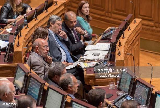 Portuguese centreright CDSPP party member of Parliament Telmo Coreia listens to a parliamentarian remarks on Portugal recent forest fires at the...