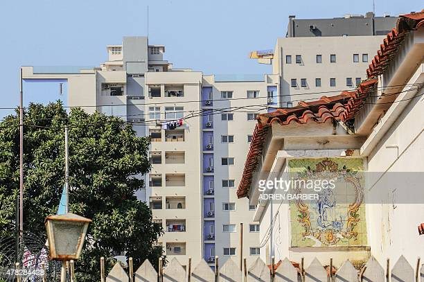 Portuguese colonial era tiles are seen on a private residence with the backdrop of a newly built apartment block in Maputo on the eve of the 40th...