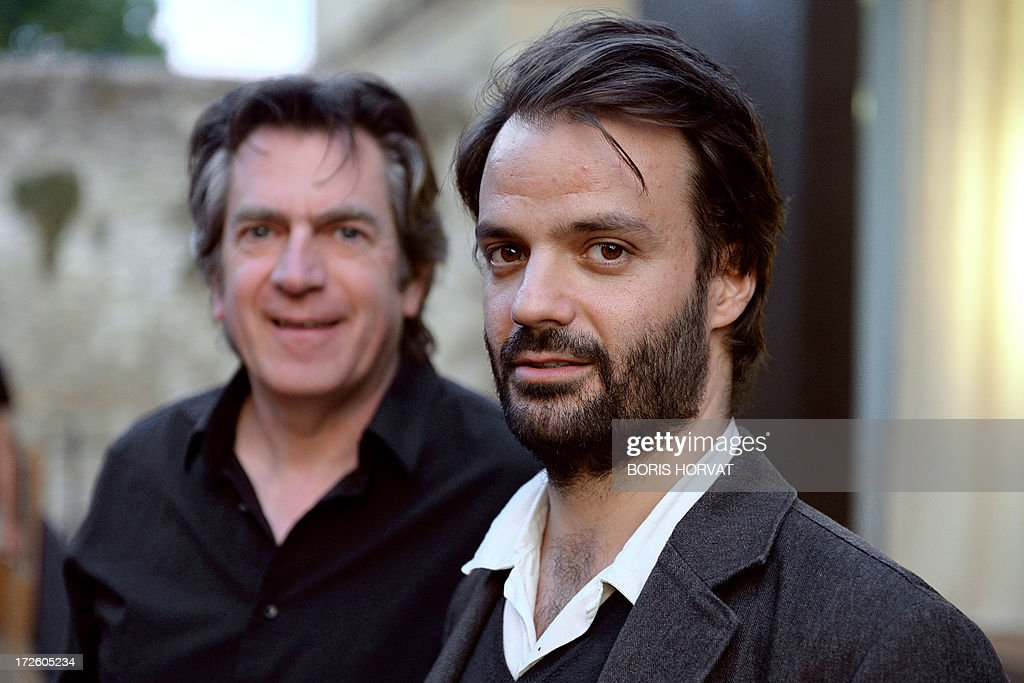 Portuguese composer Vasco Mendonca (R) is pictured with Belgian conductor Etienne Siebens before the rehearsal of the opera 'The House Taken Over', composed by Mendoca and directed by Britain's Katie Mitchell, during the Aix-en-Provence Opera Festival on July 3, 2013 in Aix-en-Provence, southern France. AFP PHOTO / BORIS HORVAT