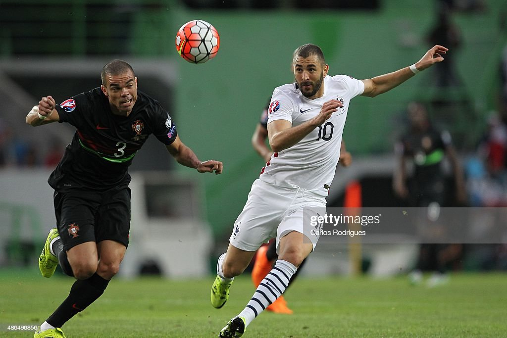 Portuguese defender <a gi-track='captionPersonalityLinkClicked' href=/galleries/search?phrase=Pepe+-+Portuguese+Soccer+Player&family=editorial&specificpeople=4401229 ng-click='$event.stopPropagation()'>Pepe</a> vies with French forward <a gi-track='captionPersonalityLinkClicked' href=/galleries/search?phrase=Karim+Benzema&family=editorial&specificpeople=796089 ng-click='$event.stopPropagation()'>Karim Benzema</a> during the Friendly match between Portugal and France on September 04, 2015 in Lisbon, Portugal.