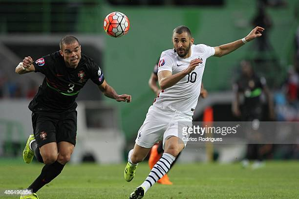 Portuguese defender Pepe vies with French forward Karim Benzema during the Friendly match between Portugal and France on September 04 2015 in Lisbon...