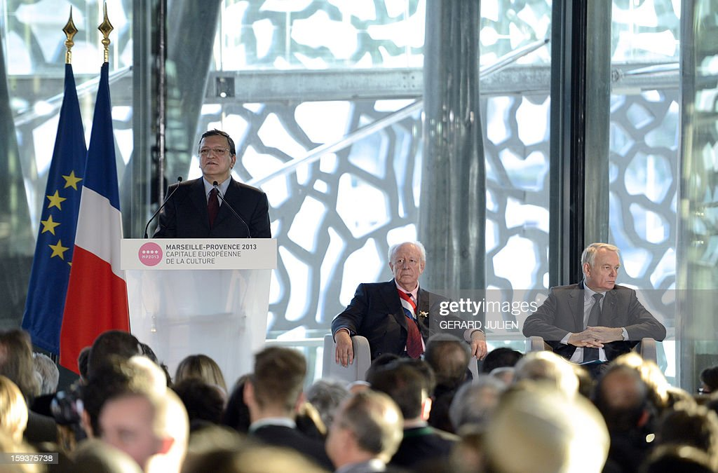 Portuguese European Commission President Jose Manuel Barroso (L) gives a speech next to French Prime Minister Jean-Marc Ayrault (R) and Mayor of Marseille Jean-Claude Gaudin (C), on January 12, 2013 in Marseille, southern France, on the construction site of the Museum of Civilisations from Europe and the Mediterranean (MUCEM) as part of the opening festivities marking Marseille as the 2013 European Capital of Culture.