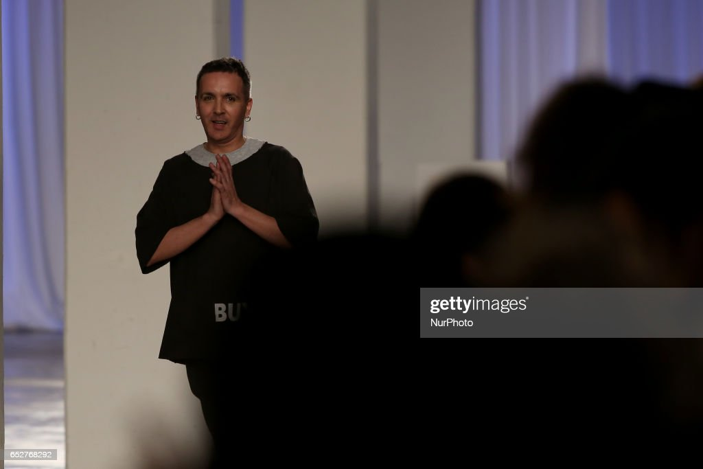 Portuguese fashion designer Dino Alves acknowledges cheers after presenting the Fall/Winter 2017/2018 collection during the Lisbon Fashion Week - ModaLisboa on March 12, 2017 in Lisbon, Portugal.
