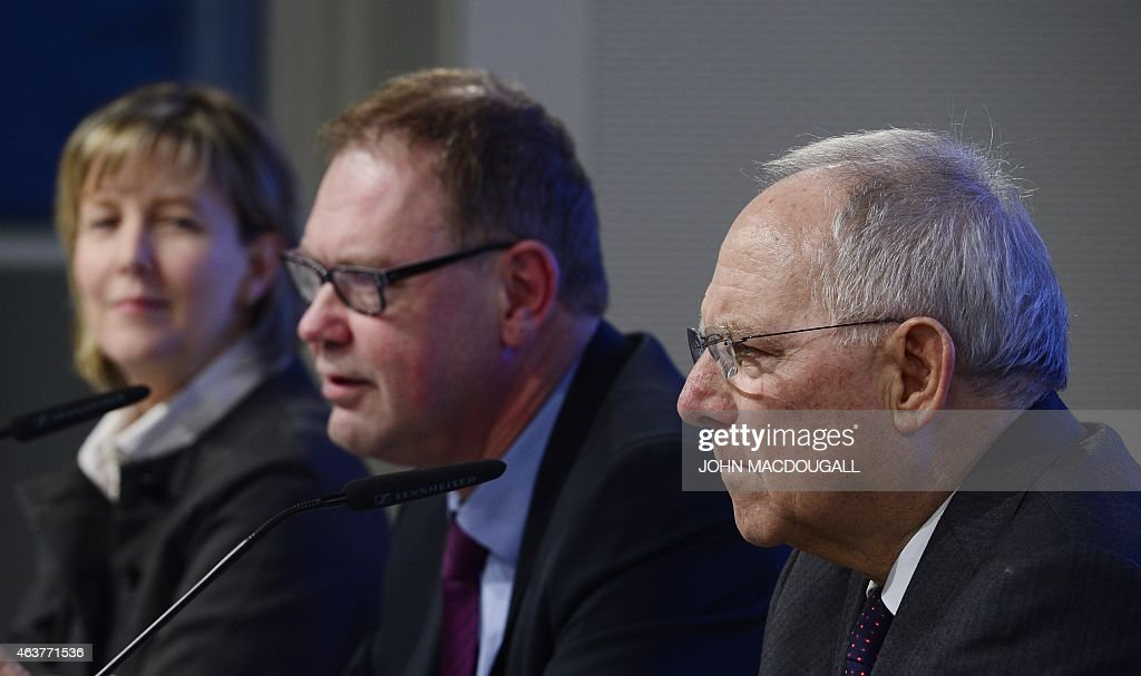 Portuguese Finance Minister Maria Luis Albuquerque, chairman of the board of the Bertelsmann Foundation Aart Jan de Geus and German Finance Minister Wolfgang Schaeuble attend the event 'Strengthening Of The European Economy' of the Bertelsmann Foundation in Berlin, on February 18, 2015. The foundation focuses on researching, publishing and stimulating public debate on political, social, economic, educational, cultural and health-related issues.