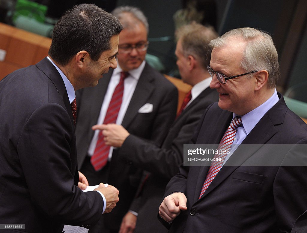 Portuguese Finance Minister Vitor Gaspar (L) and EU Commissioner for Economic and Monetary Affairs Olli Rehn talk prior to a Eurozone meeting on March 15, 2013 at the EU Headquarters in Brussels. Finance ministers of the euro zone were expected late on March 15 afternoon to try to complete the plan of aid to Cyprus, wishing to obtain the eurozone and the IMF loan of 17 billion euros the equivalent of the gross domestic product.