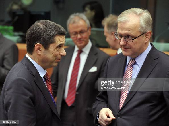 Portuguese Finance Minister Vitor Gaspar and EU Commissioner for Economic and Monetary Affairs Olli Rehn talk prior to a Eurozone meeting on March 15...
