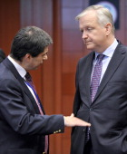 Portuguese finance minister Vitor Gaspar and EU commissioner for Economic and Monetary Affairs Olli Rehn talk prior to an Eurozone meeting on May 13...