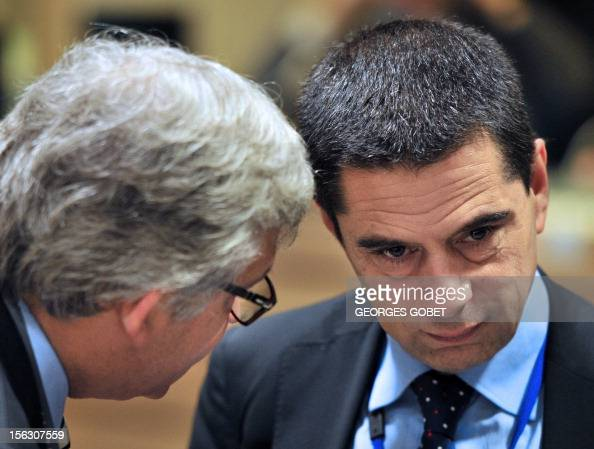 Portuguese Finance Minister Vitor Gaspar listens to his advisor prior to a meeting with European finance ministers on November 13 2012 at the EU...
