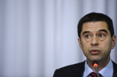 Portuguese Finance Minister Vitor Gaspar speaks to journalists during a press conference for the presentation of the outcome of the Troika's seventh...