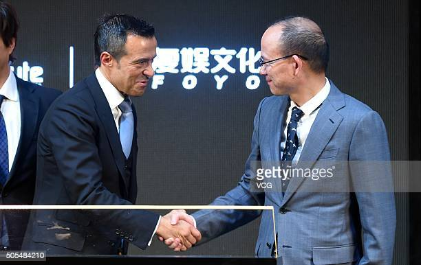 Portuguese football agent Jorge Mendes shakes hands with Guo Guangchang Chairman of Fosun Group during Gestifute and FOYO strategic partnership press...