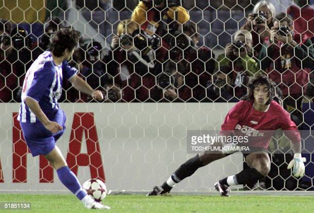 Portuguese football club FC Porto defender Pedro Emanuel scores in a penalty shootout to win the Intercontinental Cup football match in Yokohama 12...