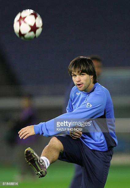Portuguese football club FC Porto midfielder Diego of Brazil kicks the ball during an official practice session at the Yokohama International Stadium...