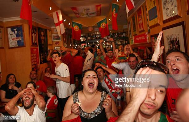 Portuguese football fans react as they watch their team's World Cup match against Brazil in a tapas bar in Vauxhall on June 25 2010 in London England...