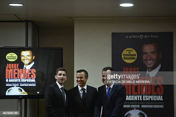Portuguese football manager Jorge Mendes poses for a photo with the writers of the book 'The Special Agent' Miguel Cuesta and Jonathan Sanchez during...