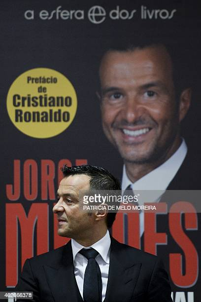 Portuguese football manager Jorge Mendes stand in front of the book 'The Special Agent' cover written by Miguel Cuesta and Jonathan Sanchez during...