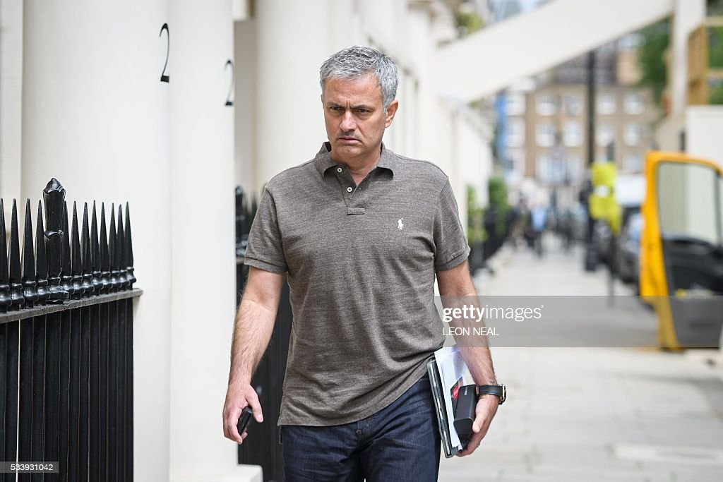 Portuguese football manager Jose Mourinho is pictured as he returns to his home in London on May 24, 2016. Mourinho is on the verge of fulfilling his dream of managing Manchester United after Louis van Gaal's troubled two-year reign at Old Trafford came to a bitter end. Van Gaal said he was 'very disappointed' to be sacked on May 23, just 48 hours after leading United to victory in the FA Cup final against Crystal Palace. / AFP / LEON