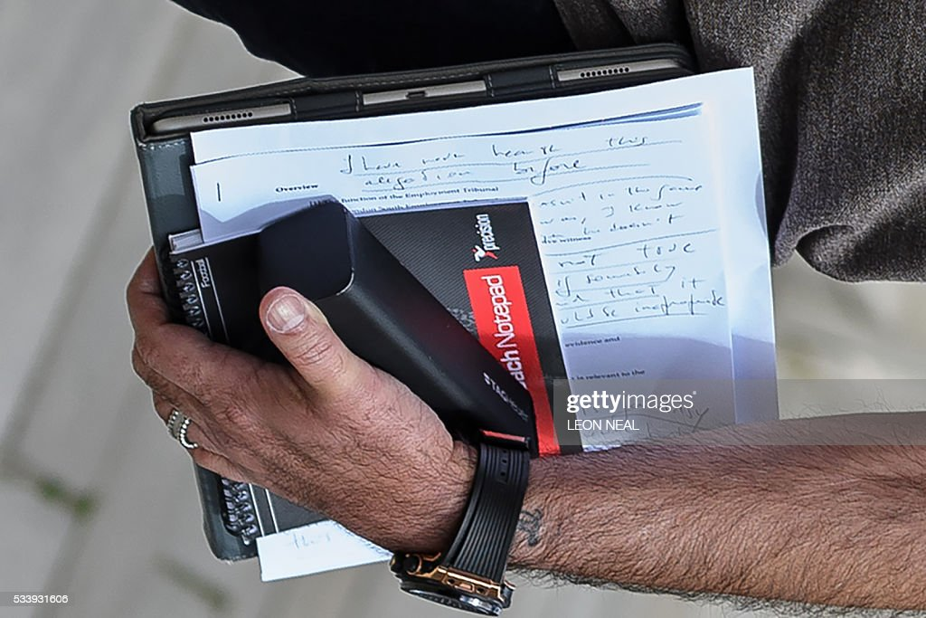 Portuguese football manager Jose Mourinho is pictured carrying written notes as he returns to his home in London on May 24, 2016. Mourinho is on the verge of fulfilling his dream of managing Manchester United after Louis van Gaal's troubled two-year reign at Old Trafford came to a bitter end. Van Gaal said he was 'very disappointed' to be sacked on May 23, just 48 hours after leading United to victory in the FA Cup final against Crystal Palace. / AFP / LEON