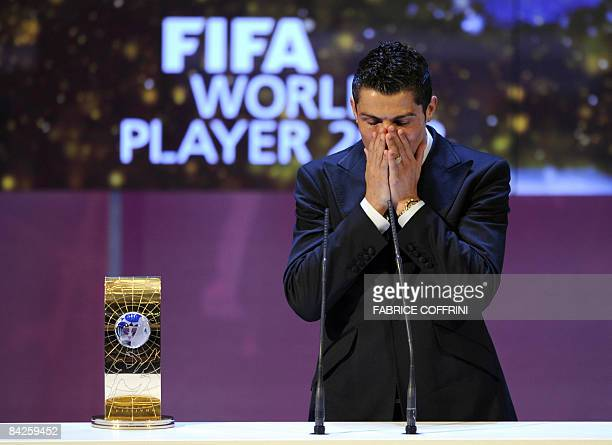 Portuguese football player Cristiano Ronaldo gestures after receiving FIFA world footballer of the year 2008 award during a ceremony on January 12...