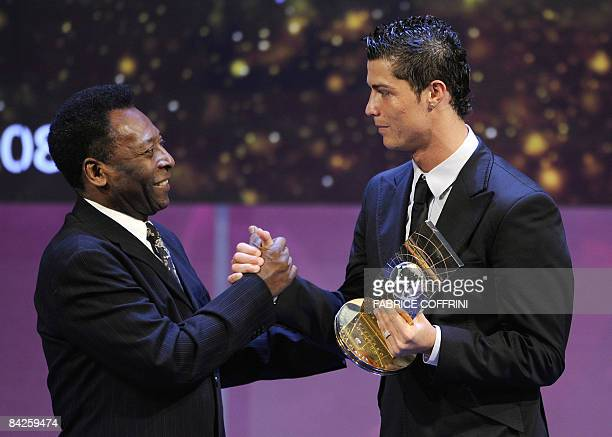 Portuguese football player Cristiano Ronaldo receives congratulations from Brazilian football legend Pele after recieving the FIFA world footballer...