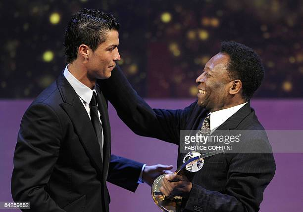 Portuguese football player Cristiano Ronaldo receives from the hands of Brazilian football legend Pele the FIFA world Footballer of the Year 2008...