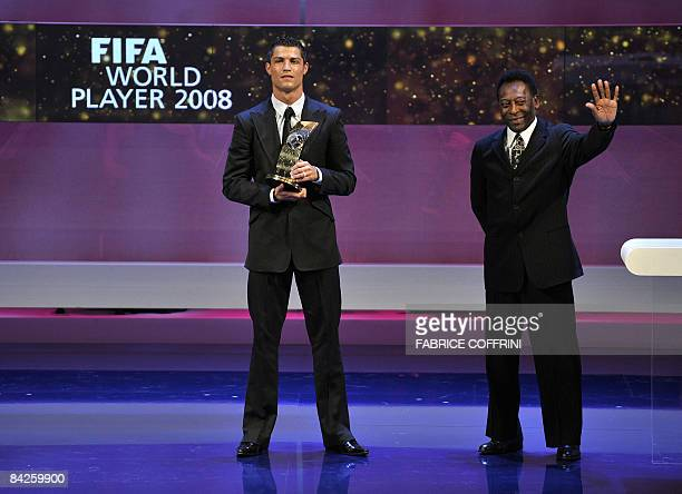 Portuguese football player Cristiano Ronaldo stands with the trophy received from the hands of Brazilian football legend Pele at the FIFA world...
