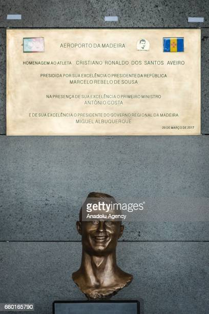 Portuguese football player Cristiano Ronaldo's bust is presented at the ceremony held to rename Madeira's airport in Funchal as Cristiano Ronaldo...