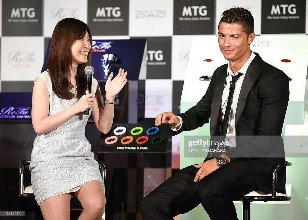 Portuguese football star Cristiano Ronaldo listens to a question from a Japanese fan during a promotional event held by his sponsor in Tokyo on July...