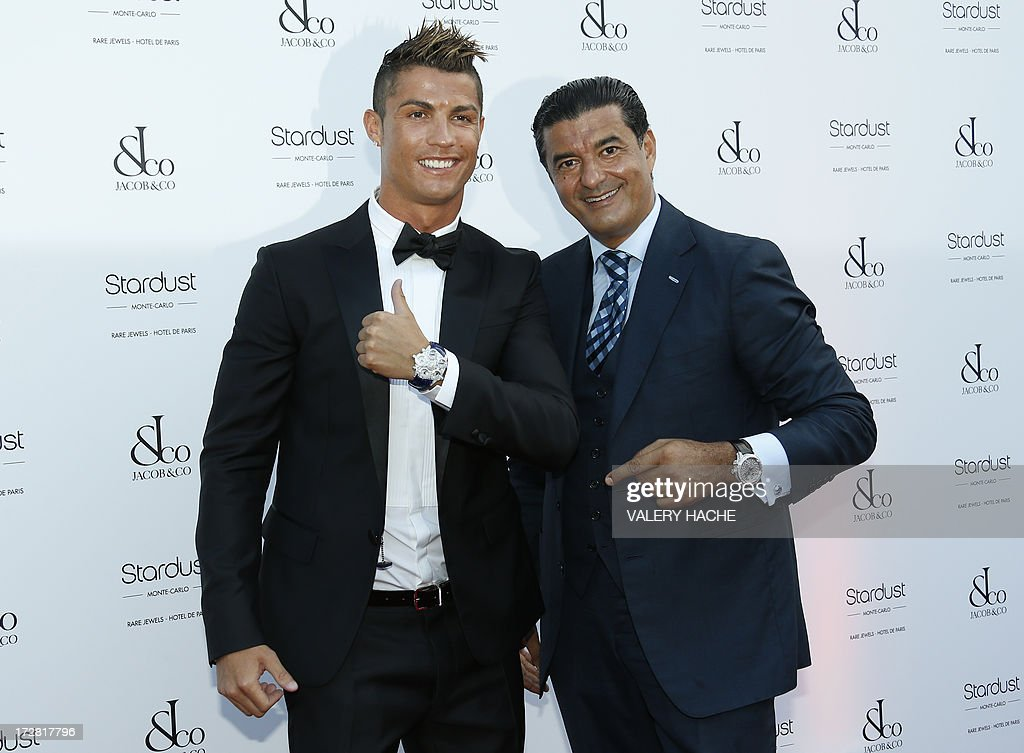 Portuguese football star Cristiano Ronaldo (L) poses with Bukharian-American jeweler and founder of 'Jacob and Co', Jacob Arabo as they arrive for the 'Jacob and Co' gala on July 4, 2013, in Monaco.