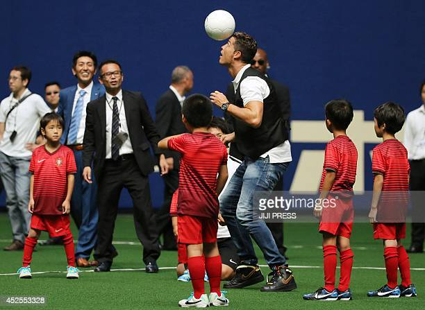 Portuguese football star Cristiano Ronaldo takes part in a football clinic for Japanese children in Nagoya in Aichi prefecture central Japan Ronaldo...