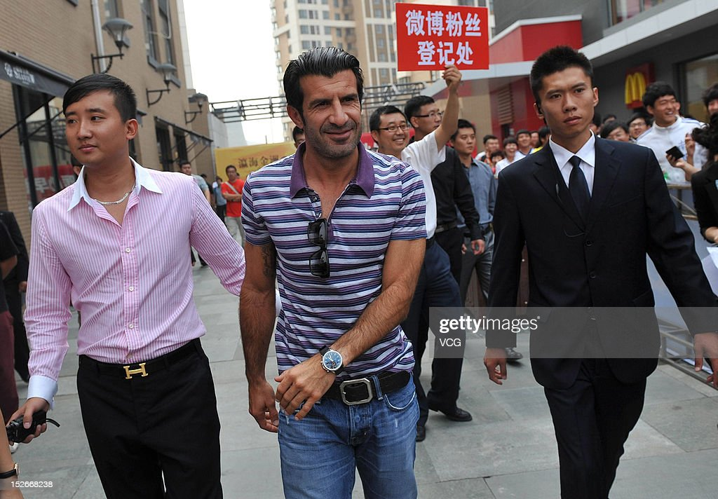 Portuguese footballer <a gi-track='captionPersonalityLinkClicked' href=/galleries/search?phrase=Luis+Figo&family=editorial&specificpeople=201507 ng-click='$event.stopPropagation()'>Luis Figo</a> attends a meet and greet with fans on September 23, 2012 in Dalian, Liaoning Province of China.