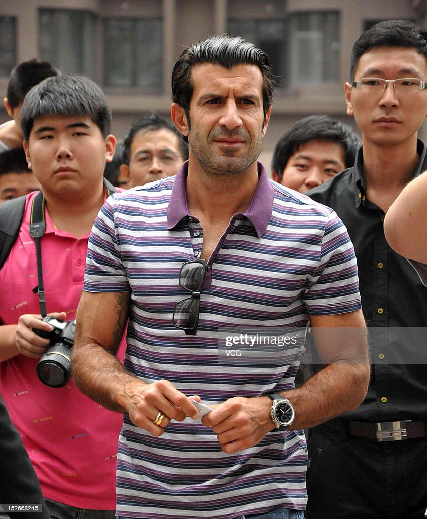 Portuguese footballer Luis Figo attends a meet and greet with fans on September 23, 2012 in Dalian, Liaoning Province of China.
