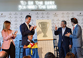 Portuguese forward Cristiano Ronaldo applauds beside his son Cristiano Ronaldo Jr in front of the owner and chairman of Pestana Hotel Group Dionisio...