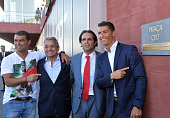 Portuguese forward Cristiano Ronaldo poses with his brother Hugo Aveiro owner and chairman of Pestana Hotel Group Dionisio Pestana and the regional...