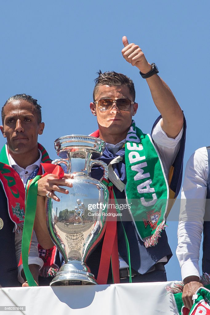 Portuguese forward Cristiano Ronaldo showing the European cup to the supporters during the meeting with the Portuguese President Marcelo Rebelo de Sousa for the Portugal Euro 2016 Victory ceremonies at Lisbon on July 11, 2016 in Lisbon, Portugal.