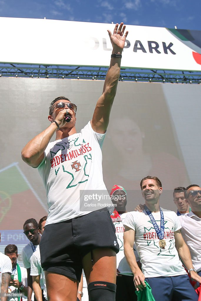 Portuguese forward Cristiano Ronaldo speaks to the Portuguese supportes during the Portugal Euro 2016 Victory Parade at Lisbon on July 11, 2016 in Lisbon, Portugal.