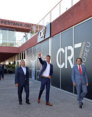 Portuguese forward Cristiano Ronaldo thumbs up flanked by the owner and chairman of Pestana Hotel Group Dionisio Pestana and the regional president...