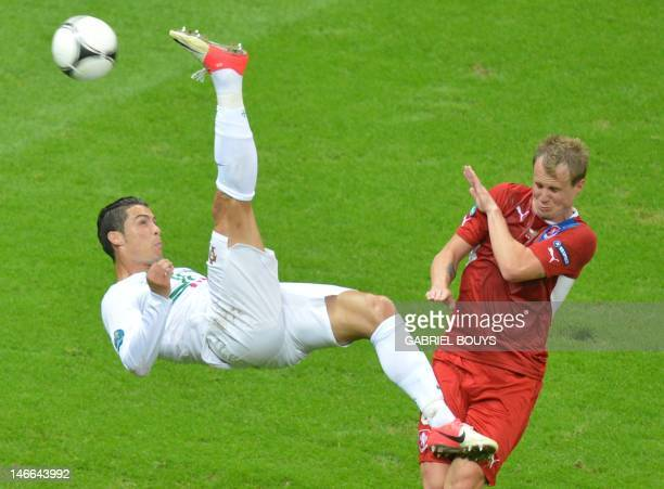 Portuguese forward Cristiano Ronaldo tries to score despite Czech defender David Limbersky during the Euro 2012 football championships quarterfinal...