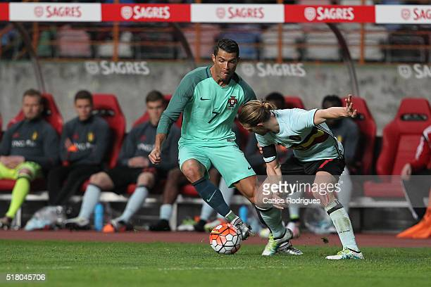Portuguese forward Cristiano Ronaldo vies with Belgium midfielder Guillaume Gillet during the match between Portugal and Belgium Friendly...