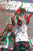 Portuguese forward Nani holds the European Cup and show it to the Portuguese supportes during the Portugal Euro 2016 Victory Parade at Lisbon on July...