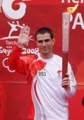 Portuguese forward of Paris SaintGermain football club Pauleta arrives with the Beijing olympic torch at the Charlety stadium on April 7 2008 in...