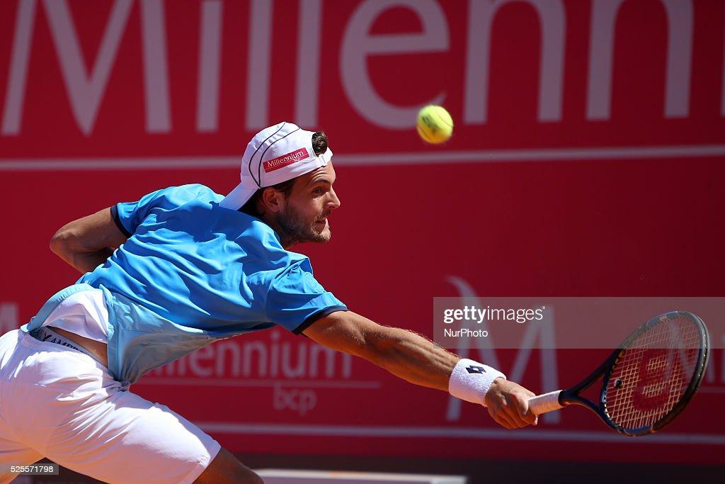 Portuguese Joao Sousa returns a ball to Spanish Nicolas Almagro during the Millennium Estoril Open ATP 250 tennis tournament at the Clube de Tenis do Estoril in Portugal on April 27, 2016.