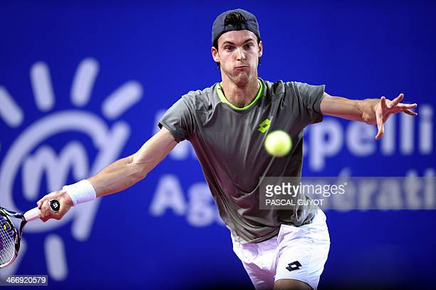 Portuguese Joao Sousa returns the ball to his opponent German Tobias Kamke during the Open Sud de France world tour ATP Series tennis match on...